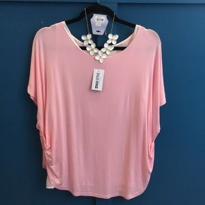 Pink Bouncy top w/pulled up sides to show layer